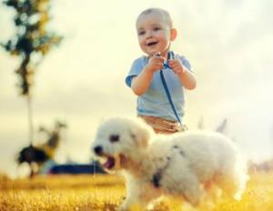 Baby_and_dog_ivanko80_Fotolia_medium