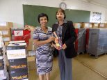 Sandra Pillay, the Programme Manager of Mama Ntombi's Community Projects hands over the stationery kits donated by Monrovia Rotary Club to Mrs. Essa, the Principal of the Umsilinga Primary School in Ezinketheni, Pietermaritzburg.