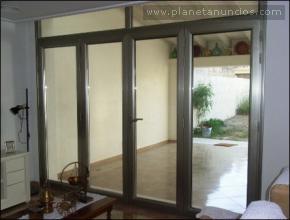 Puerta bronce de 4 hojas plegable carpinteria de for Reparacion de ventanas de aluminio