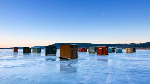 Ice fishing huts on frozen lake in New York State, USA 20130118