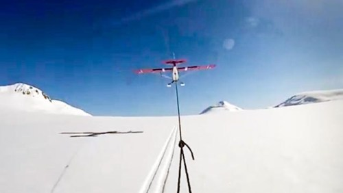 Skiier-Towed-Husky-Airplane