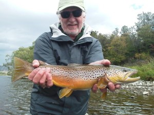 Dan shows off his catch. A beautiful pre-spawn brown sporting his fall colors!