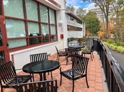 The Outside Patio Of Stone Hall With Table And Chairs A View The New