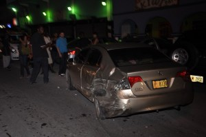 This Honda Civic took blows in the attack. Will it ever drive again? (More Bacchanal photo)