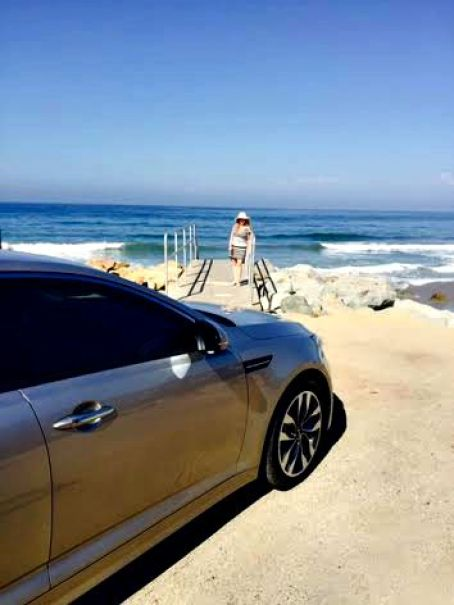 kia at the beach in SB