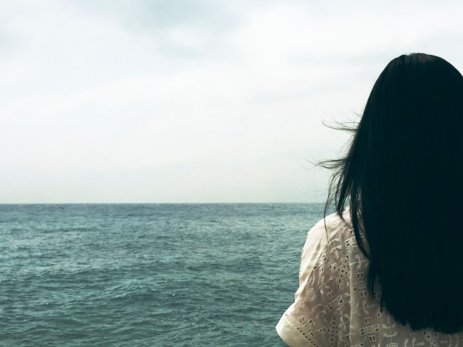 Woman and ocean photo-1432807653616-37f5f5c2508e