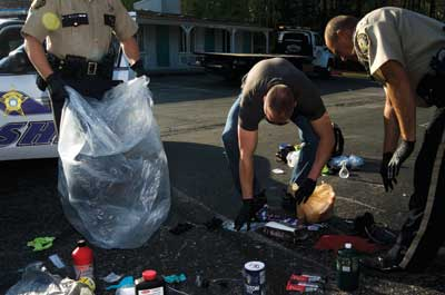 Police cleaning up a meth lab