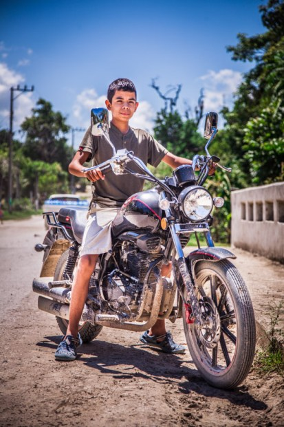 A local kid, beautifully captured by Nik while sitting on his motorbike