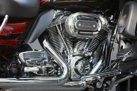 Chrome, glorious chrome! The Road Glide Ultra is slathered in it, looking especially tasty in the Screamin&amp;rsquo; Eagle TC110 engine compartment. Note the heat deflector behind the rear cylinder to deflect hot air away from a rider&amp;rsquo;s leg. 