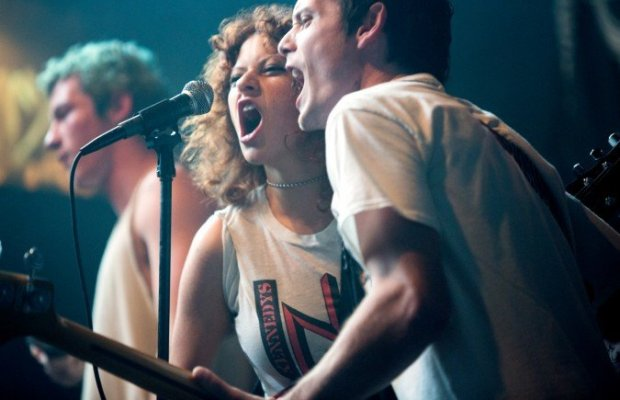Caption: Sam (Alia Shawkat) and Pat (Anton Yelchin) getting real into it on stage