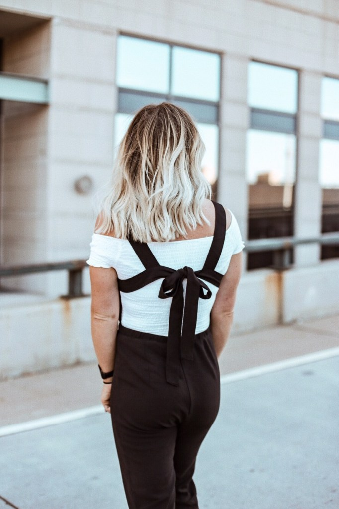 black jumpsuit by Christine Bennett of Moxie Fashion Blog