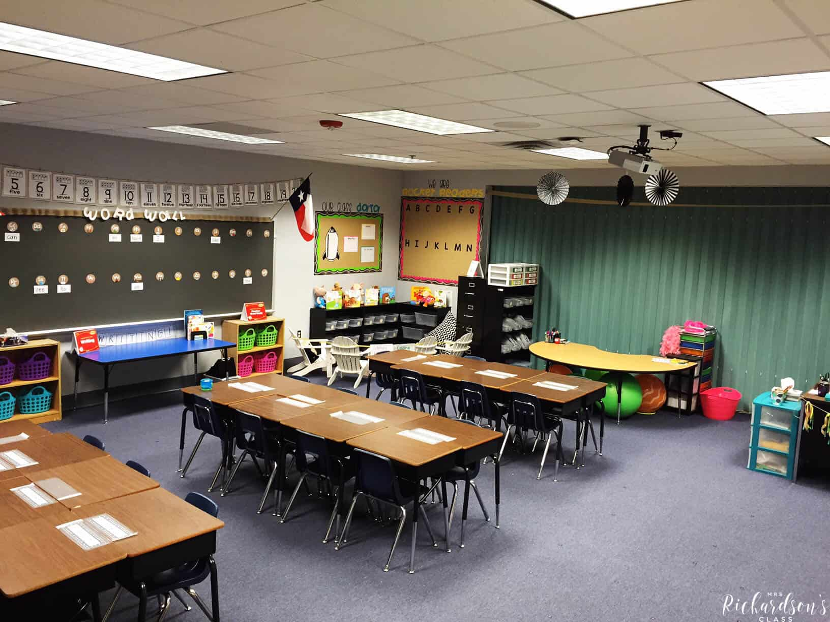 Chalkboard, burlap, and bright classroom decor that is simple and affordable! I love how inviting this learning environment is, too!