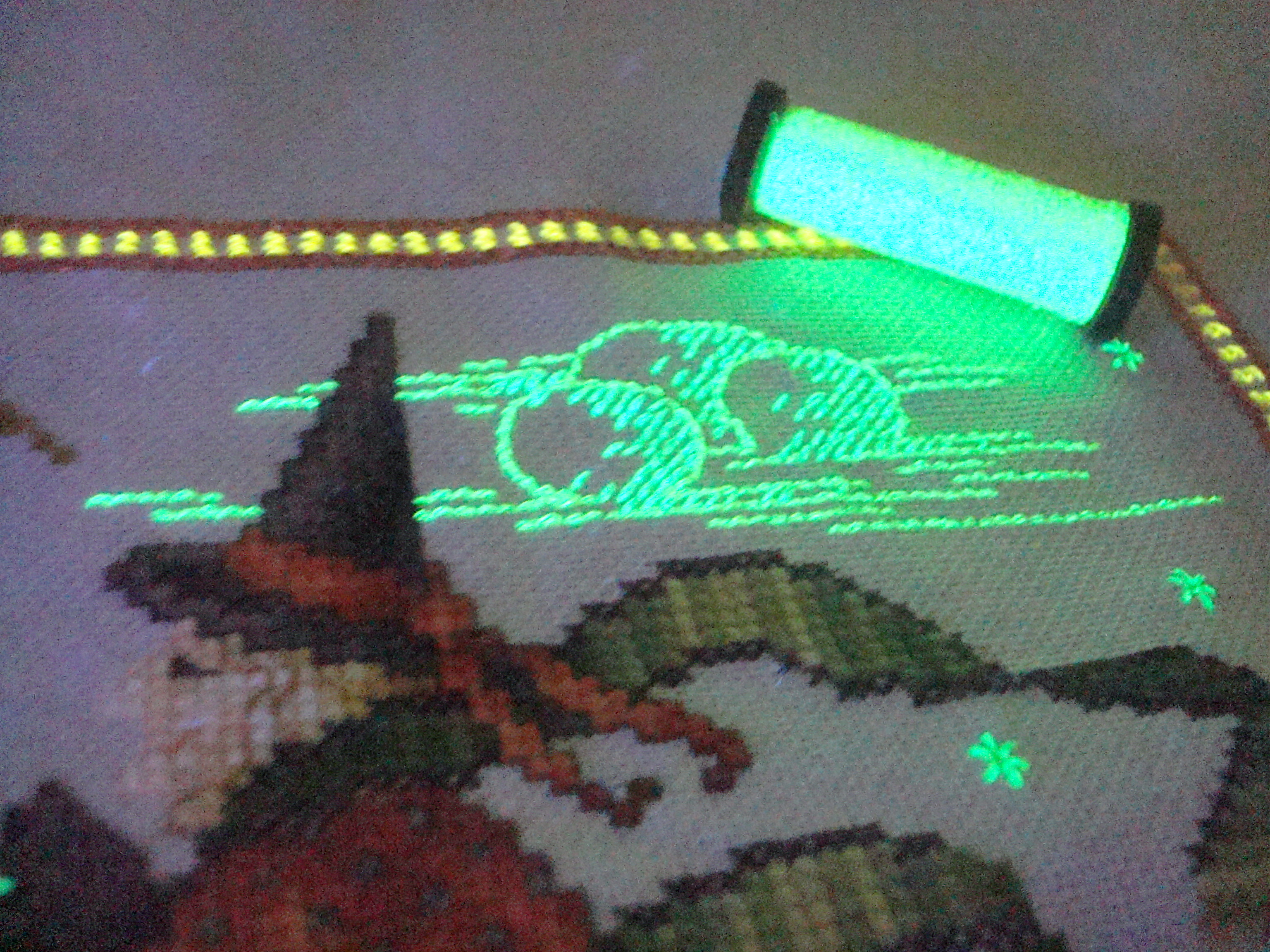 "Glow-in-the-dark threads are a fun element to add to any design. They are especially perfect for anything that ""glows"" in real life, such as moonlight. Photo is from a design by Kreinik."