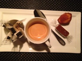 Delicious espresso with caramel and madeleine post-meal in France
