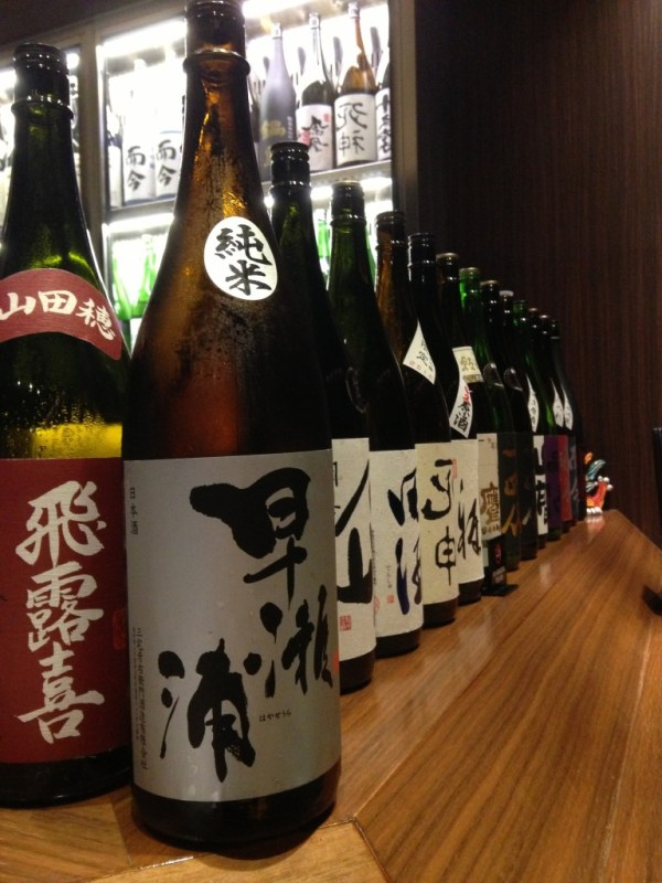 Huge sake bottles in Japan, by Sara Rosso at Ms. Adventures in Italy