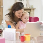 photodune-339635-mother-and-baby-in-home-office-with-laptop-xs