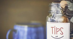 Tip jar in coffee shop or restaurant. American currency