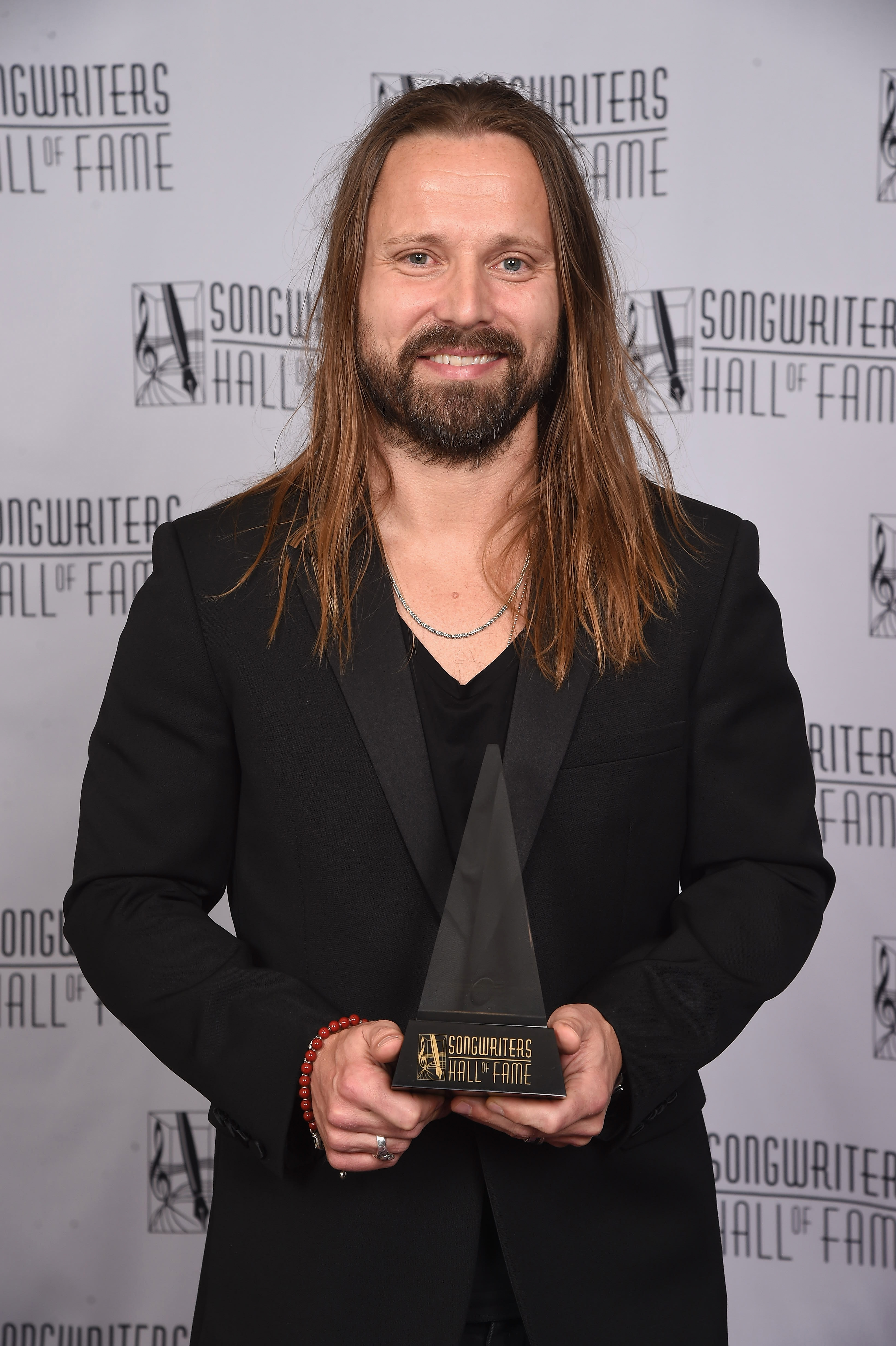 NEW YORK, NY - JUNE 15:  2017 Inductee Max Martin poses with his award backstage at the Songwriters Hall Of Fame 48th Annual Induction and Awards at New York Marriott Marquis Hotel on June 15, 2017 in New York City.  (Photo by Gary Gershoff/Getty Images for Songwriters Hall Of Fame) *** Local Caption *** Max Martin