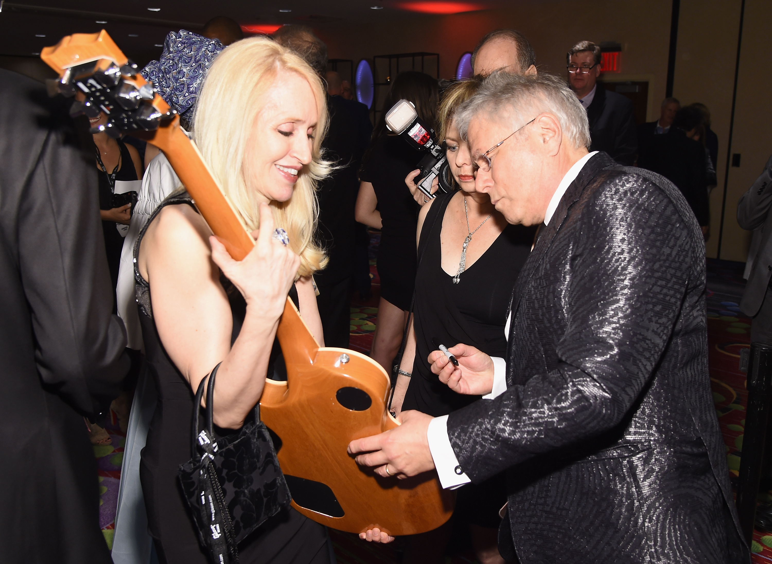NEW YORK, NY - JUNE 15:  Johnny Mercer Award Honoree Alan Menken signs a guitar backstage at the Songwriters Hall Of Fame 48th Annual Induction and Awards at New York Marriott Marquis Hotel on June 15, 2017 in New York City.  (Photo by Larry Busacca/Getty Images for Songwriters Hall Of Fame) *** Local Caption *** Alan Menken