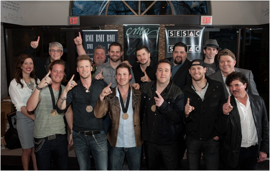 """Pictured (L-R): Front Row – BMI's Penny Everhard; Florida Georgia Line's Tyler Hubbard and Brian Kelley; co-writers Jesse Rice, Joey Moi, and Chase Rice; and Big Machine Label Group's Scott Borchetta; Back Row (l-r): Republic Nashville's Jimmy Harnen; Big Loud Mountain's Craig Wiseman, Seth England, and Kevin """"Chief"""" Zaruk; SESAC's Tim Fink; Artist Revolution Publishing's Sam Brooker; and BMI's David Preston. Photo Credit: Steve Lowry"""