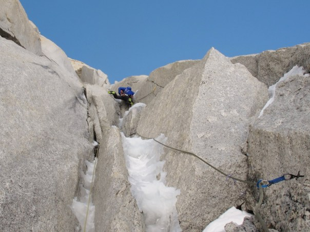 Leading up some great ice runnels capped by small roofs. Photo - Dave Macleod