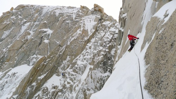 Dave looking up at the technical groove high on the route. Photo - Calum Muskett