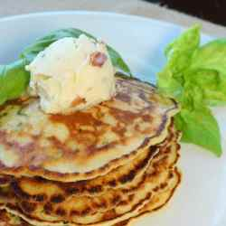 Fresh chopped basil and creamed corn are the simple ingredients make these savory Basil Corn Cakes so moist and flavorful. Served with Maple Bacon Butter, these corn cakes make a perfect and memorable brunch or side dish.