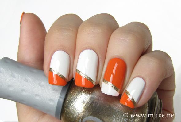 Orange and white nail design