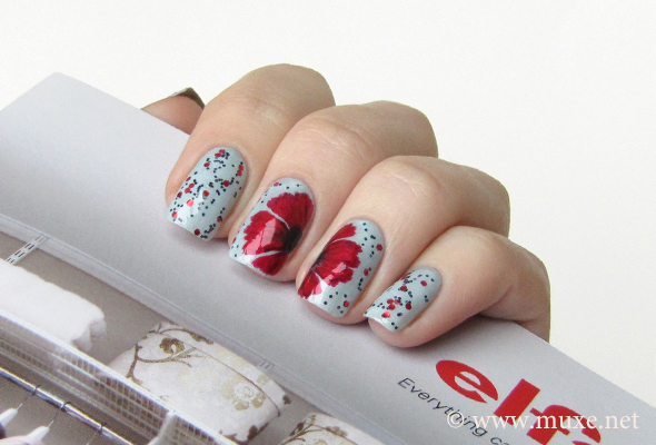 Red poppy nail design