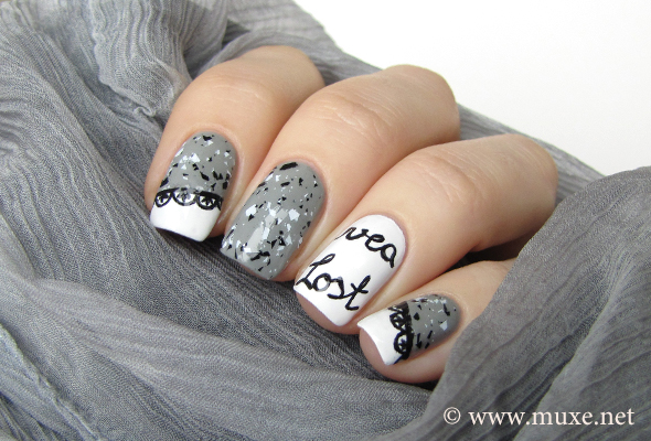 Grey and white nail art with laces
