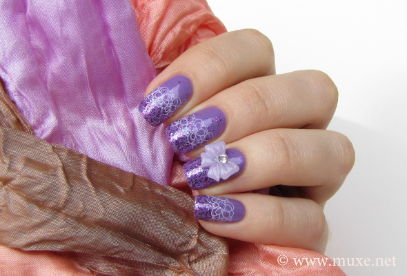 Lilac glitter nail art with stamping