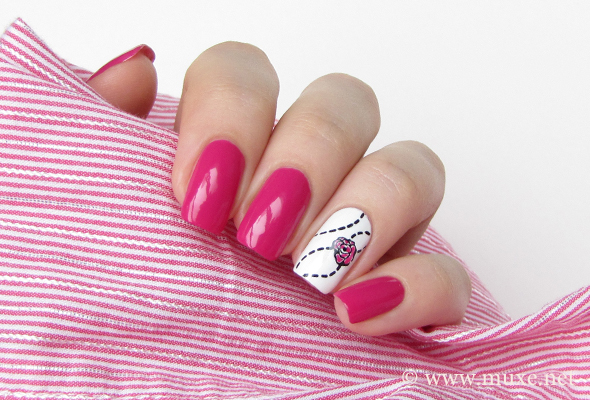 Pink nails with white rose design