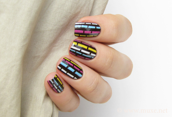 Brown nail design with stripes