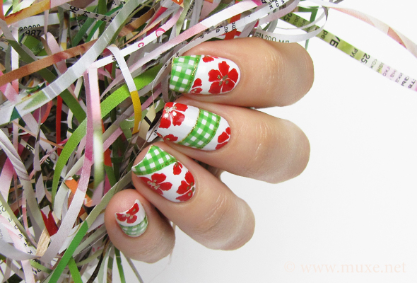 White nails with red flowers design