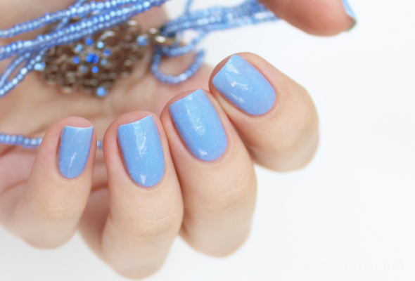 Light blue flakes nail polish