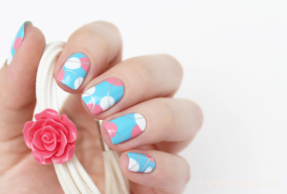 White and blue nail design with circles