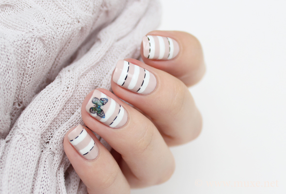 Butterfly nail design on nude