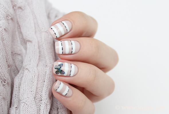 Striped nails with nude and white