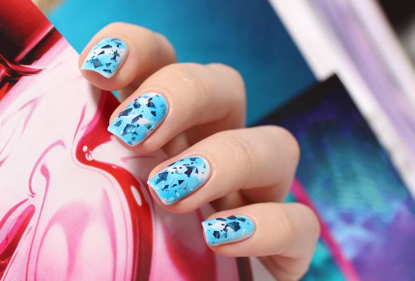 Blue ice glitter nail design
