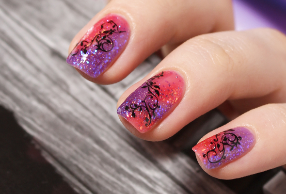 Red purple floral nail design
