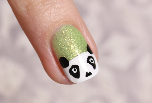 Panda nail design on green