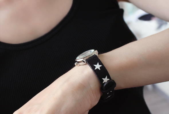 Women watches in black with white stars