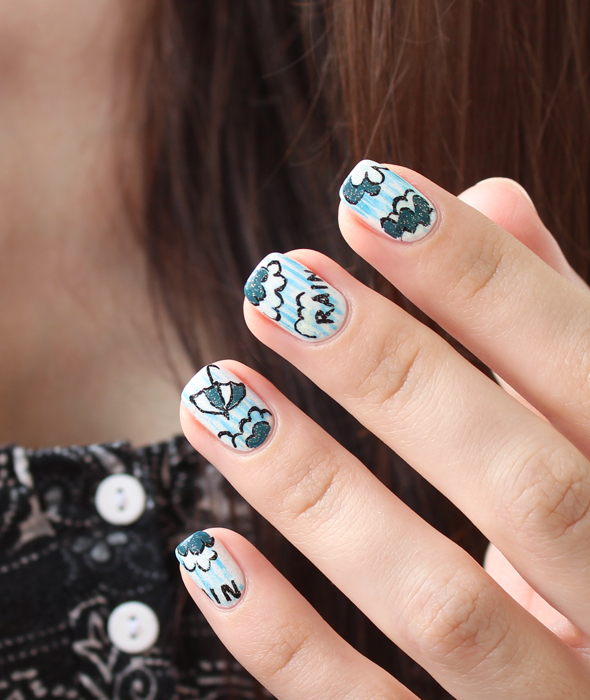 Summer rain umbrella nail design in white and blue
