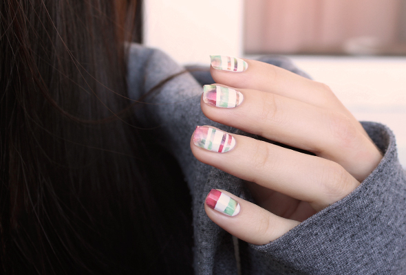 Abstract stripes nail design over white