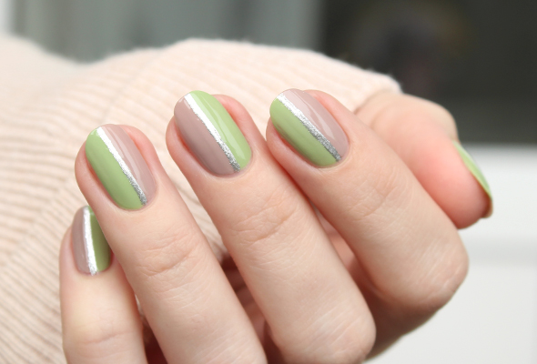Beige and green nails with silver stripes