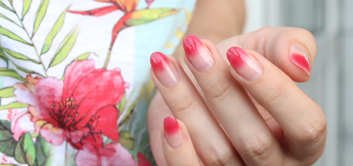 Negative space nail art in pink
