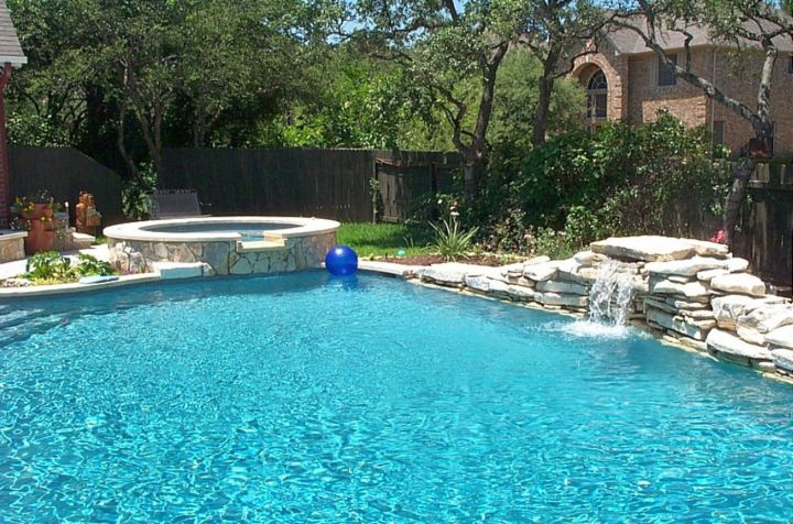 17 simply gorgeous pool waterfall ideas for Beautiful swimming pool designs