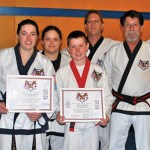 Alex Rindos, center, earns his first-degree black belt in Tang So Do and Jill Fitzpatrick, left, earns her second-degree black belt. They are both from Beacon Falls Karate School, which is run by Master Howard Daniels. Also pictured are Jackie Fitzpatrick, Howard Daniels III and Master Howard Daniels.