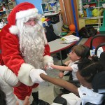 Santa Claus pays a visit to Wilson Elementary School students Wednesday.