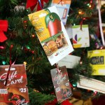 Donated gift cards worth hundreds of dollars decorate one of the trees.  - PHOTO BY  LARAINE WESCHLER